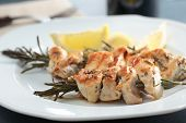 foto of souvlaki  - Chicken souvlaki on rosemary sticks with lemon - JPG