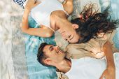 Above View Image Of Beautiful Couple In Love Dating Outdoors At The Park On A Sunny Day. Couple Lyin poster