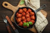 Top View Of Delicious Meatballs With Tomato Sauce And Fresh Basil In Cast Iron Rustic Vintage Pan Se poster