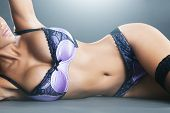 Body of sexy woman with long hair in purple lingerie