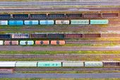 Aerial View Of Various Railway Carriage Trains With Goods On The Railway Station, Top View poster