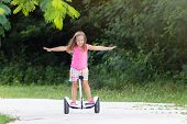 Child On Hover Board. Kids Riding Scooter poster