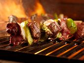 stock photo of grill  - beef kababs on the grill closeup - JPG