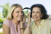 foto of early 60s  - Mother and Daughter Sharing Headphones - JPG