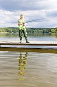 stock photo of fisherwomen  - fishing woman standing on pier - JPG