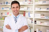 stock photo of coat tie  - Portrait American pharmacist at work - JPG