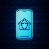 Glowing Neon Mobile Phone With House Under Protection Icon Isolated On Brick Wall Background. Protec poster