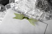 stock photo of wedding invitation  - black and white with green on wedding invitation up close - JPG