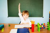 Back To School Concept. Cheerful Schoolboy Ready To Answer Question poster