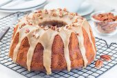 Sweet Potato And Pecan Nuts Pound Cake With Caramel Icing On A  Cooling Rack, Horizontal poster