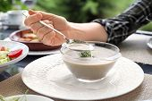 Vegan Mushroom Cream Soup In A Plate And A Hand Holds A Spoon. Healthy Vegetarian Mushroom Soup In A poster
