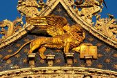picture of porphyry  - The Venetian lion on a cathedral building on San Marco square - JPG