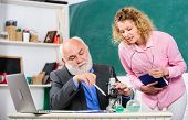 Teacher And Girl With Notepad Near Chalkboard. Biology Science. Study Biology. Biological Research.  poster