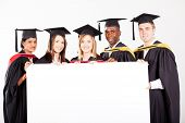 foto of graduation hat  - group of graduates with white board - JPG