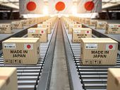 Made in Japan. Cardboard boxes with text made in Japan and chinese flag on the roller conveyor. 3d i poster