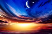 Beautiful Dark Fluffy Cloudy Sky With Sun Rays . Crescent Moon With Beautiful Sunset Background . Ge poster