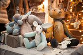 Toys Made By Hand Are Sitting On The Table. Cute Soft Toys, Animals, Rabbit, Cat And Elephants On Th poster