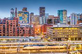 Denver, Colorado, USA downtown cityscape over the train station at twilight. poster