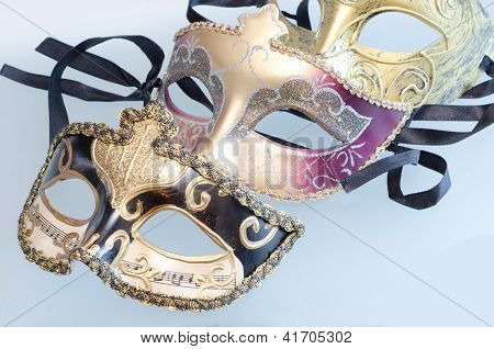 Venetian masks with shining glow of stars