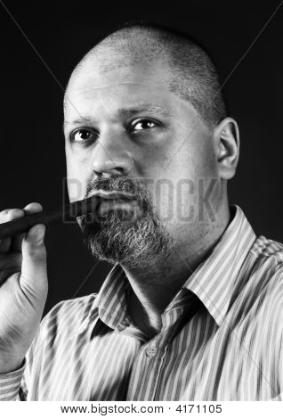 Mature Man With Cigar