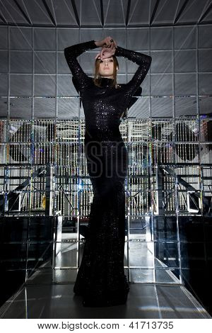 Beautiful woman in long black dress - mirror room