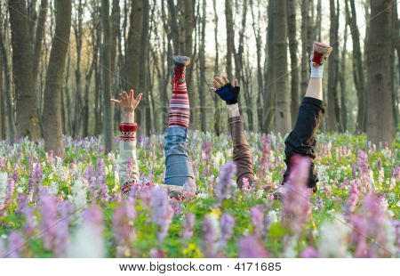 Feet And Hand In Flowers