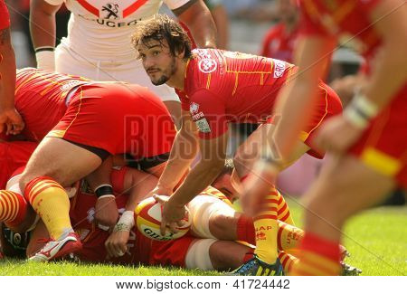 BARCELONA - SEPT, 15: Florian Cazenave of USAP Perpignan in action during the French rugby league match USAP Perpignan vs Stade Toulousain at the Olympic Stadium in Barcelona, on September 15, 2012