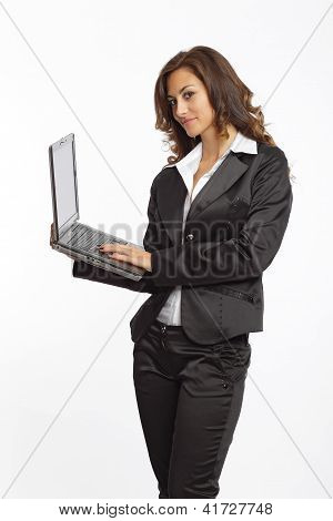 Woman in black suit working with a notebook