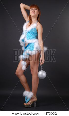 Fairy With Christmas Ball On Dark Background