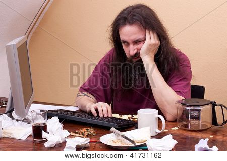 Frustrated Man Sitting On The Pc And Is Thinking