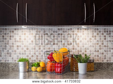 Vegetables, Fruits And Herbs In A Kitchen With Cozy Lighting