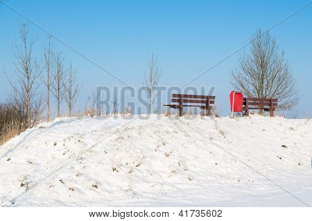 Wooden Bench In Sunny Winter Landscape