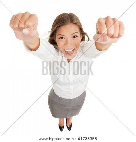 Happy jubilant you woman cheering. Fun high angle perspective of a vivacious jubilant you woman cheering and raising her clenched fists arms to the camera in her excitement isolated on white
