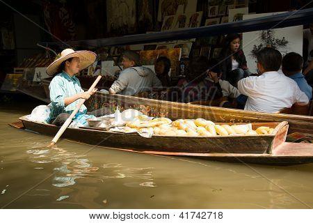 Mango Seller and Tourist at Damnoen Saduak Floating Market, Thailand