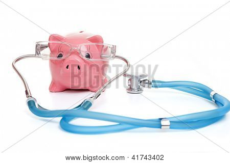 medical insurance concept with stethoscope money and glasses