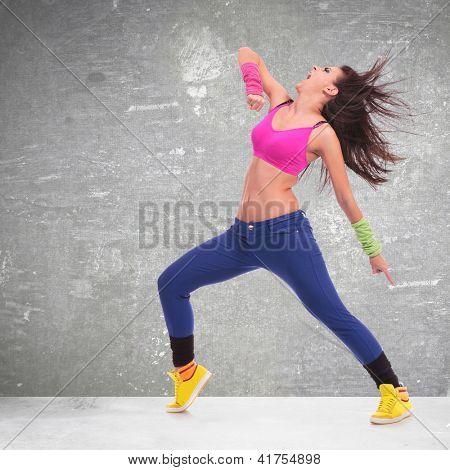 headbanging modern style dancer posing on black background