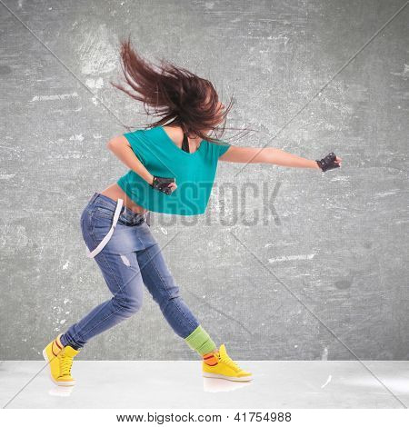 headbanging woman dancer  in a full of energy dance move and screaming