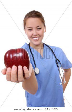 Female Doctor Holding Apple