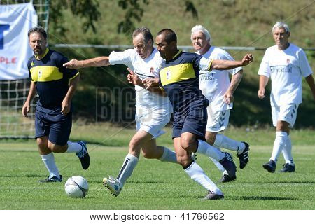BUDAPEST - SEPTEMBER 9: Unidentified players in action at a I. International Senior Football Festival game Rakosmenti TK HUN (white) vs. Pantanal BRA (black) September 9, 2012 in Budapest.