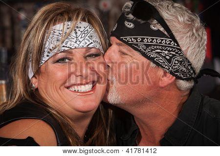 Mature Bearded Man Kisses Woman