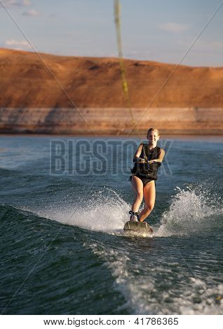 Blonde Wakboarding At Sunset