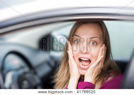 Shocked woman in a car
