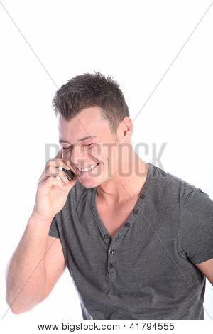 Young Man Laughing On His Mobile Phone