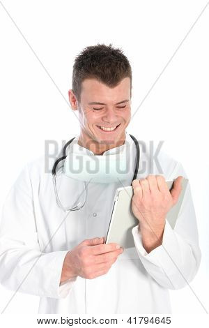 Doctor Smiling At Information On His Tablet