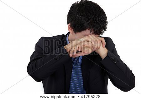 Man hiding his face in shame