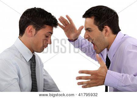 Man shouting at colleague
