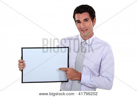 Man pointing at white box
