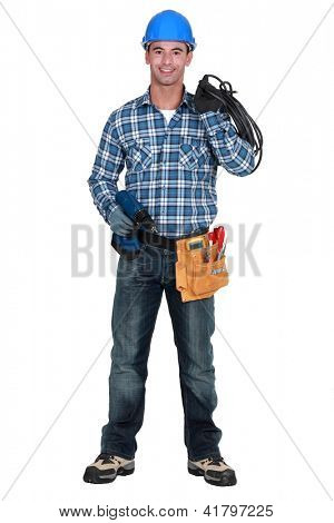 Craftsman with  tools and hand drill
