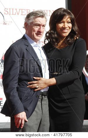LOS ANGELES, CA - FEB 4: Robert De Niro, wife Grace Hightower at a ceremony where Robert De Niro is honored with hand and foot prints at TCL Chinese Theater on February 4, 2013 in Los Angeles, CA
