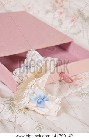 Pink present with cream and blue garter for the bride
